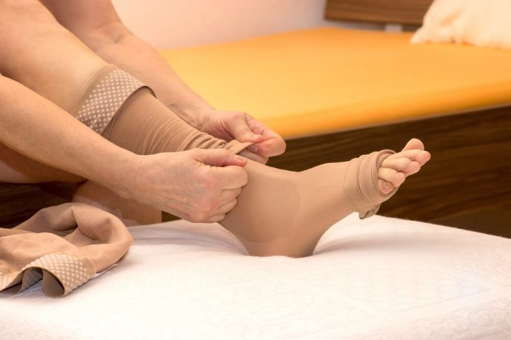 Female-putting-thrombosis-stockings-on-e1463730201244.jpg