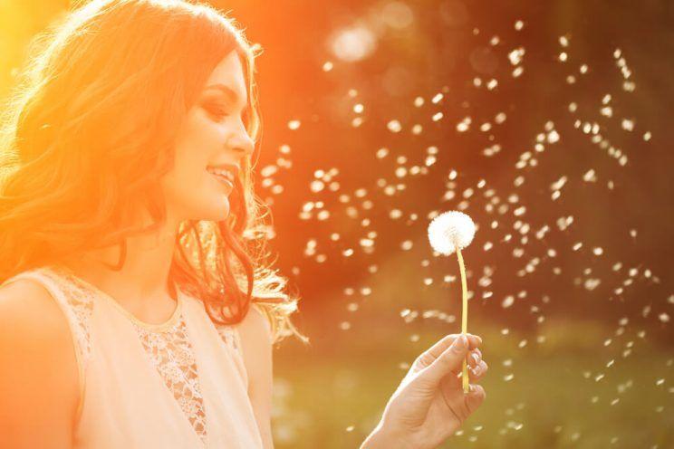 woman-blowing-dandelion-in-garden-e1465008146230.jpg