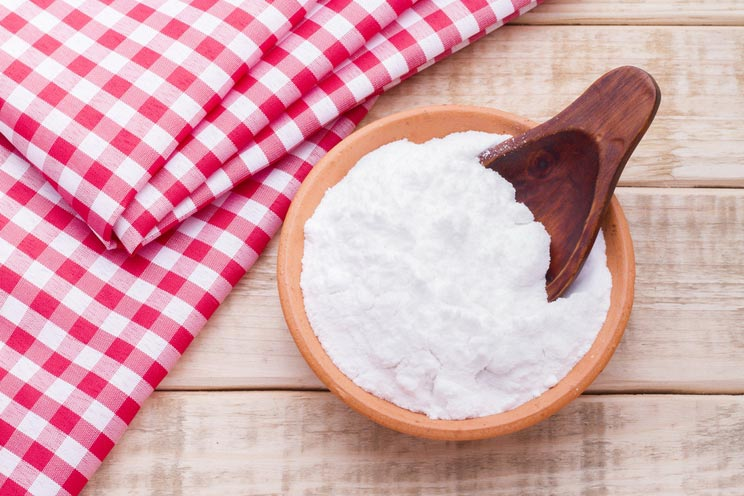 Baking-soda-in-a-bowl-with-spoon-and-dough-cloth.jpg