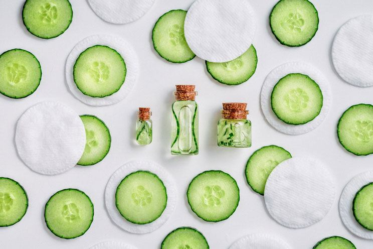 Fresh-skin-care-tonic-for-face-cucumber-slices-cotton-pads-and-bottle-with-tonic.jpg