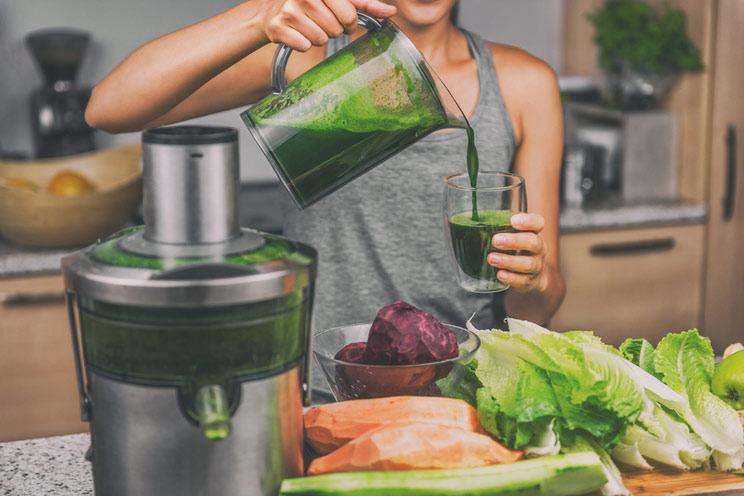 Woman-juicing-making-green-juice.jpg