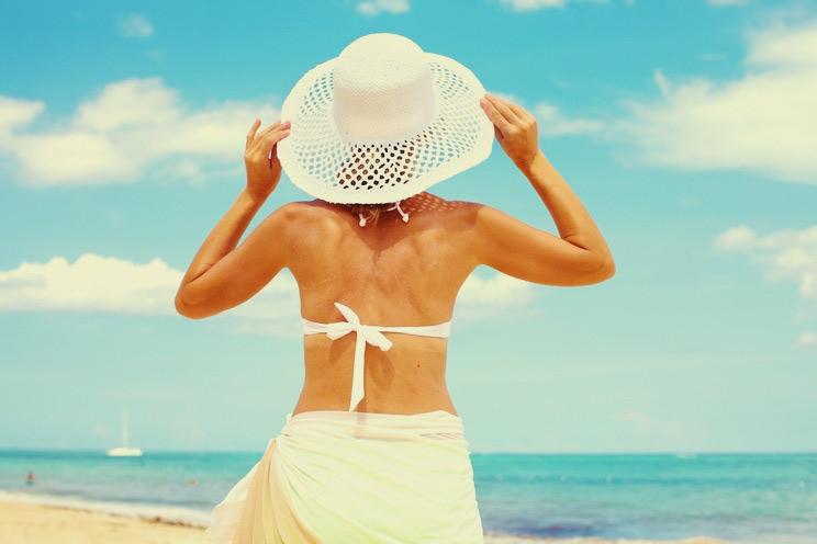 Happy-beautiful-woman-on-the-beach.jpg